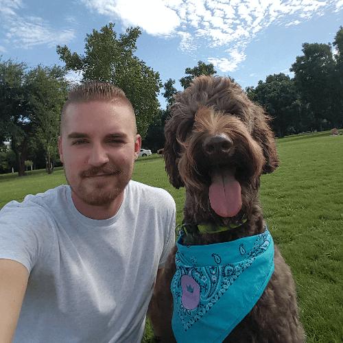 Shane Burkhart with his dog, Yogi.