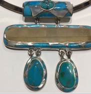 AJTA Sleeping Beauty Turquoise W/ Singing Quartz Pendant