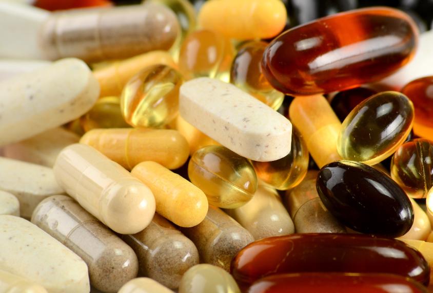 Close-up photo of various pills and capsules representing alternative medicines.