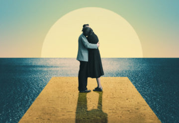 A man and woman kiss under a sunset within a surreal environment, suggesting the surreal nature of studying romantic love within the autism spectrum.