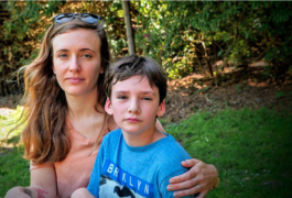 "Natalie Dunnege's son, Strazh, has autism. ""He's really a good kid,"" Dunnege says. ""But it's a lot to handle, especially as a single parent.""  Sheraz Sadiq / KQED"