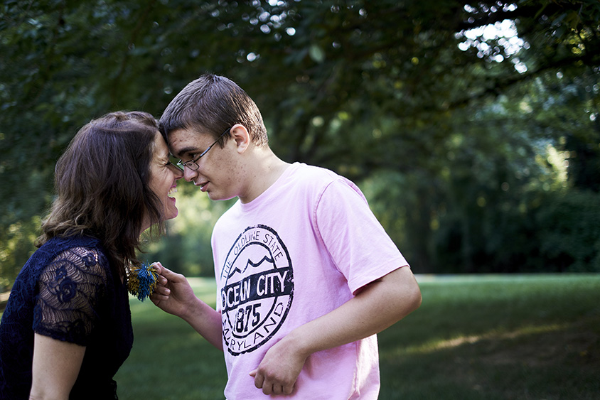 Kyle Becker, 17, shares an affectionate touch with his mother, Alison Becker, while walking at a park near home in Potomac, Md., on July 12, 2016.
