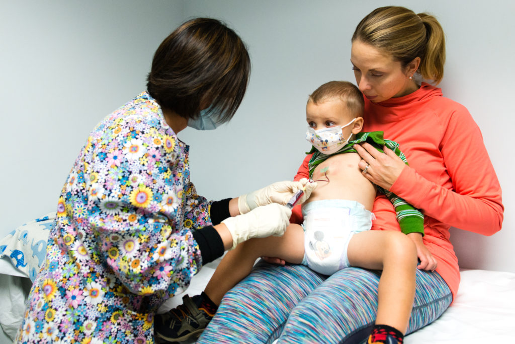 A nurse administers Luke Whitbeck's enzyme replacement through a port that was surgically placed in his chest at the Boston Children's Health Physicians pediatric infusion center in Hawthorne, New York, on 6 October 2016.