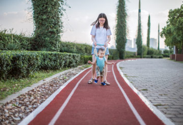 Delayed action: Children with autism who have de novo mutations in key autism genes tend to walk later than other children with the condition. HIKARU VISION / Getty Images