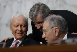 Senate Judiciary Committee member Senator John Kennedy, R-Louisiana, center, talks with Committee Chairman Senator Charles Grassley, R-Iowa, right, and Senator Orrin Hatch, R-Utah, on Capitol Hill in Washington, D.C., 21 March 2017.  Pablo Martinez Monsivais  / AP Photo