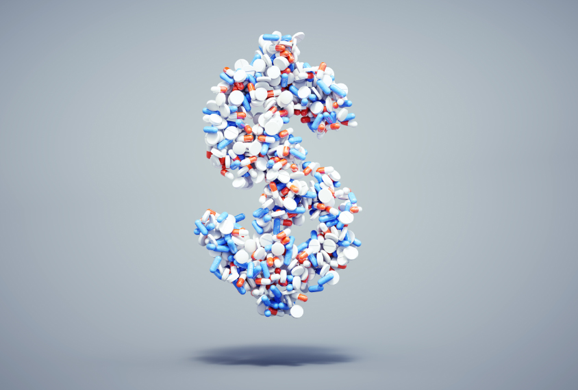 Dollar sign made out of pills float in space.