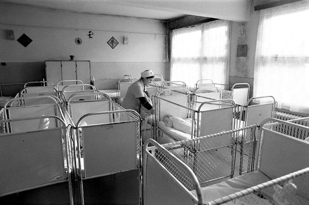 Infants at an orphanage in Bucharest, Romania, were changed and fed but otherwise ignored.Michael Carrol