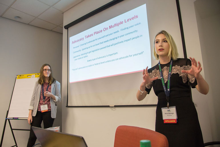 Emily Muller, left, and Shira Strongin, right, give their presentation on advocacy at the Rare Disease Legislative Advocates conference in Washington, D.C., on February 28, 2017. (H. Darr Beiser/for Kaiser Health News)