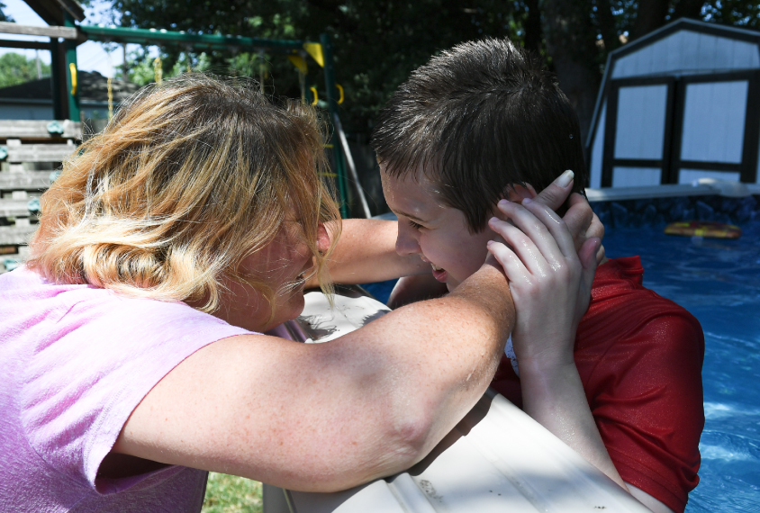 Debbie Cordone embraces her son, James, who she says benefited from intenseive behavioral therapy.