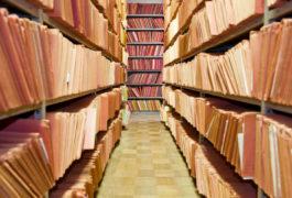 Room full of filing folders on shelves