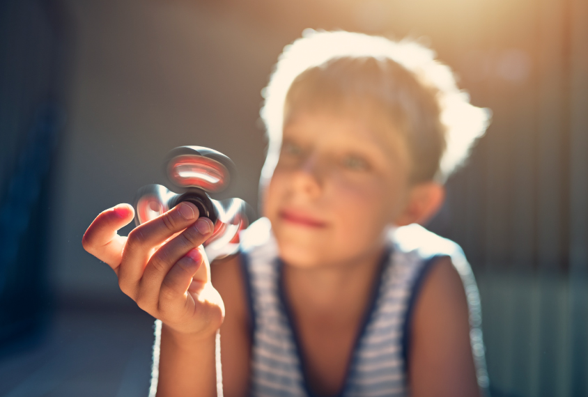 child playing with fidget spinner