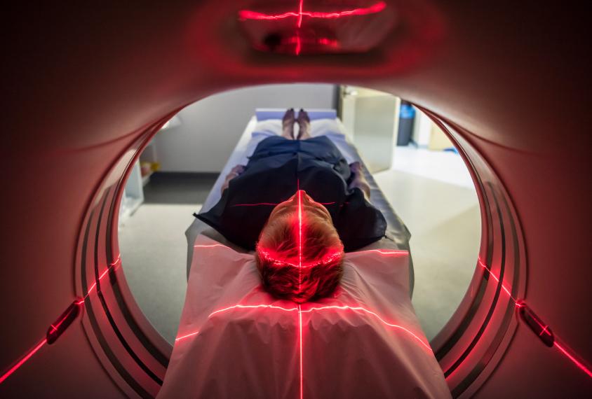 human going through MRI