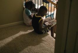 two children reading in the dark