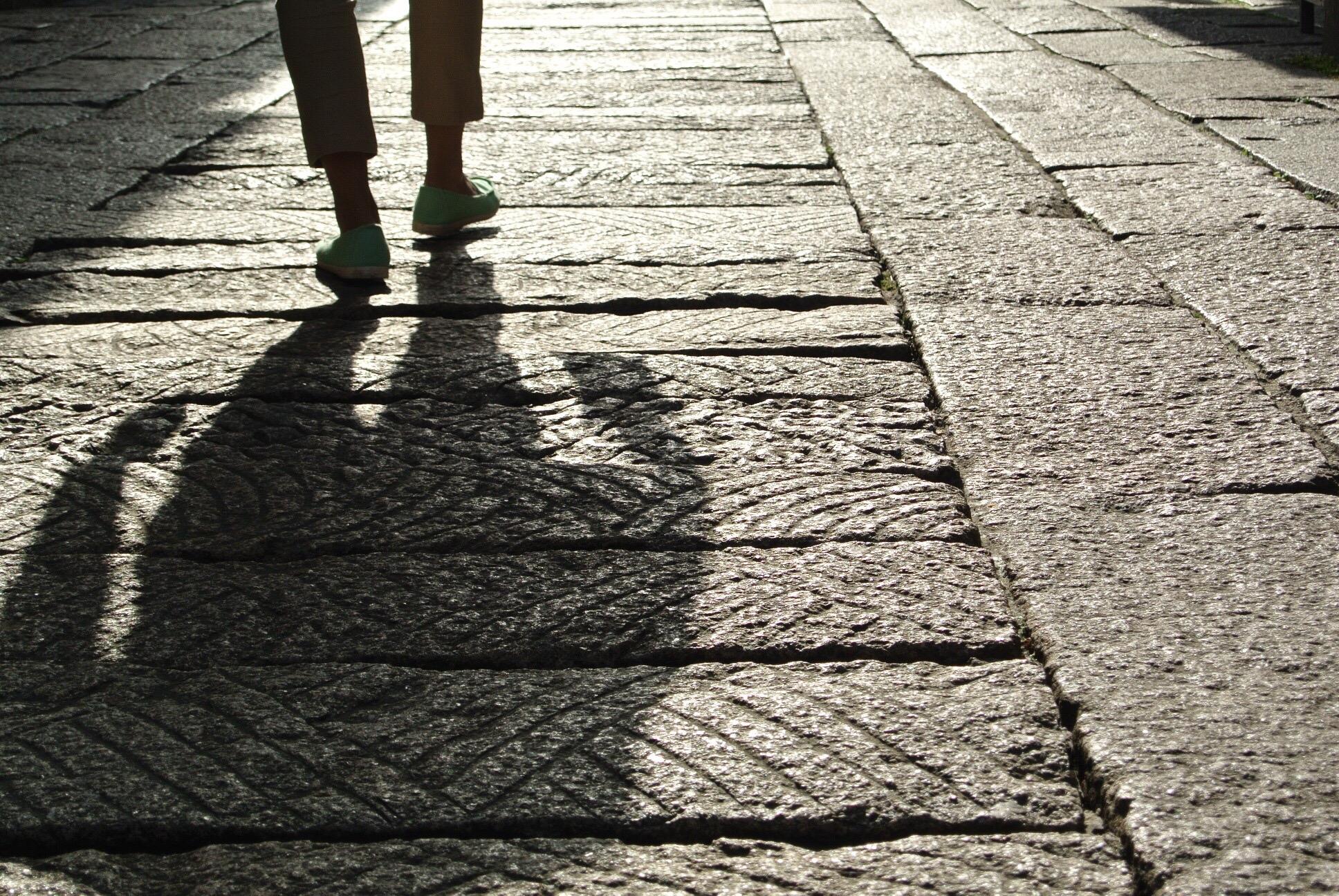 person walking down sidewalk
