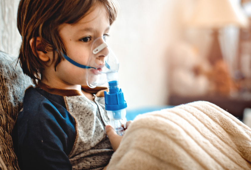 child with contraption over nose and mouth