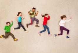 birdseye view of five children in running formation