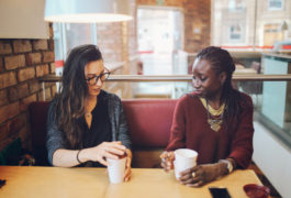 two women sitting in a coffee shop