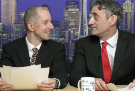 newscast scene, two men with documents