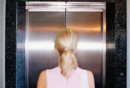 woman in front of closed elevator door