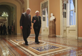 Republican Senate Majority Leader Mitch McConnell (right) and Democrat Senate Minority Leader Chuck Schumer (left) walk to the chamber after collaborating on an agreement in the Senate