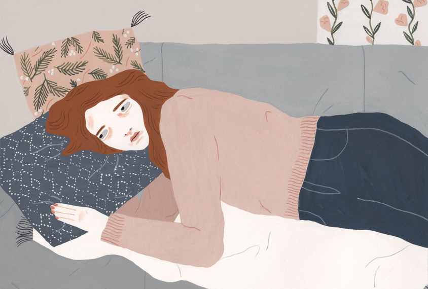 Illustration: a woman lies on a couch, on her side, looking sad.