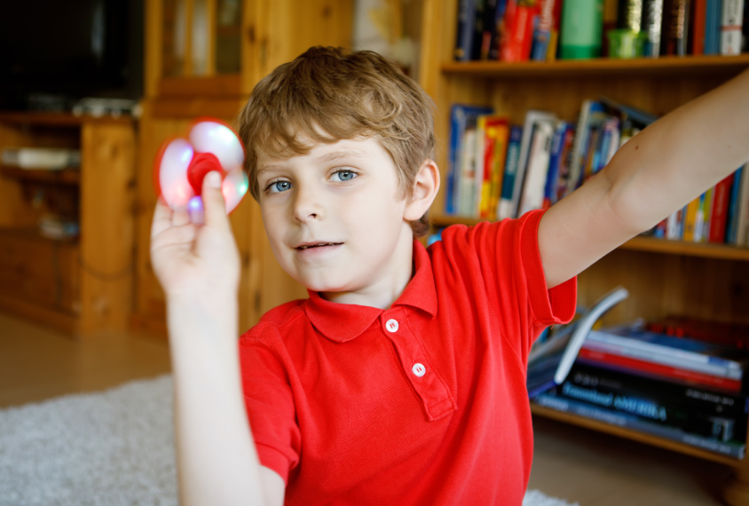 boy playing with a fidget spinner
