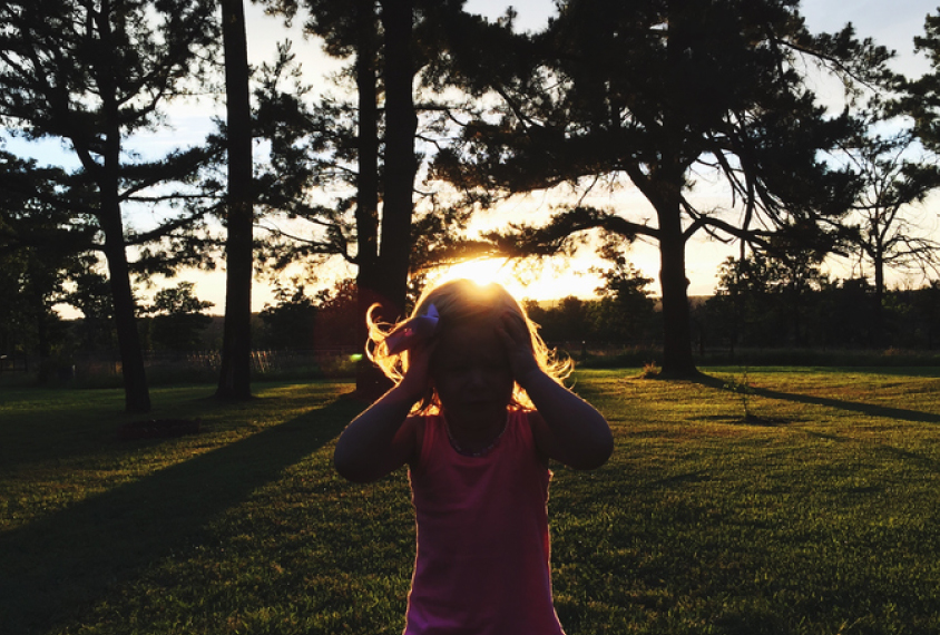 Silhouetted child in the trees