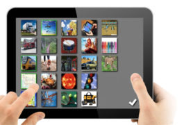 hand holding ipad with images