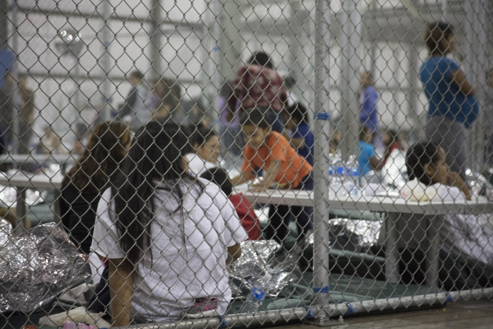 Adults and children in metal cages at the Central Processing Center in McAllen, Texas, Sunday, June 17, 2018.