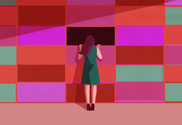 A woman peers through a wall made to look like a genetic sequencing background, through a missing area.