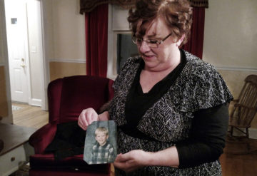Mom Toni Hoy with ah photograph of her adopted son.
