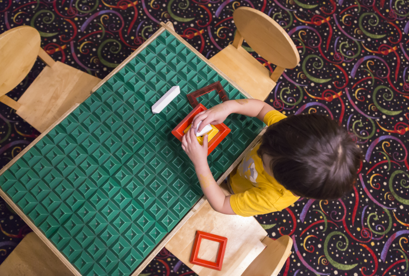 Child with educational toys