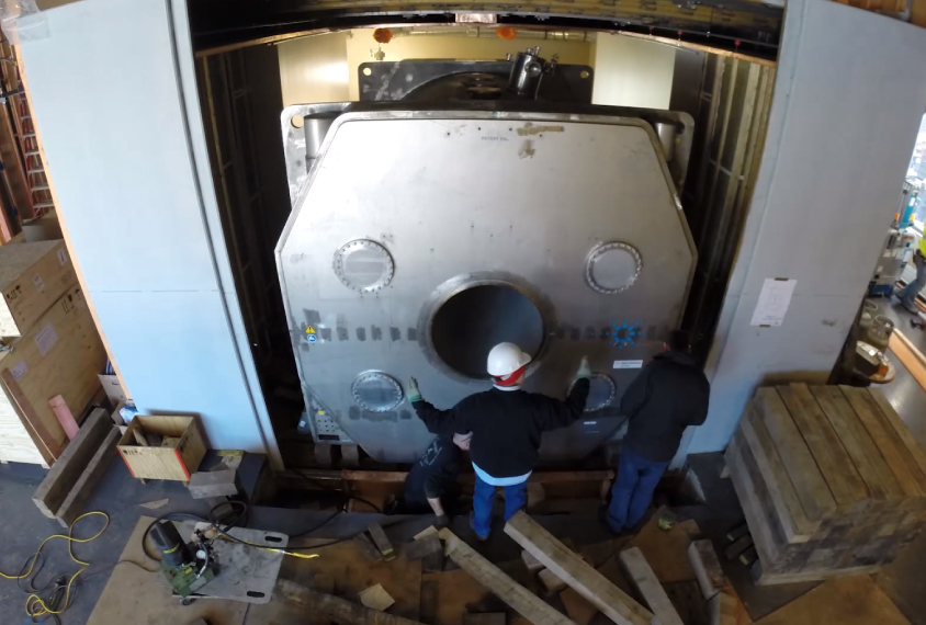 Installers working on massive MRI machine install