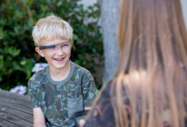 boy wearing high-tech glasses, smiling