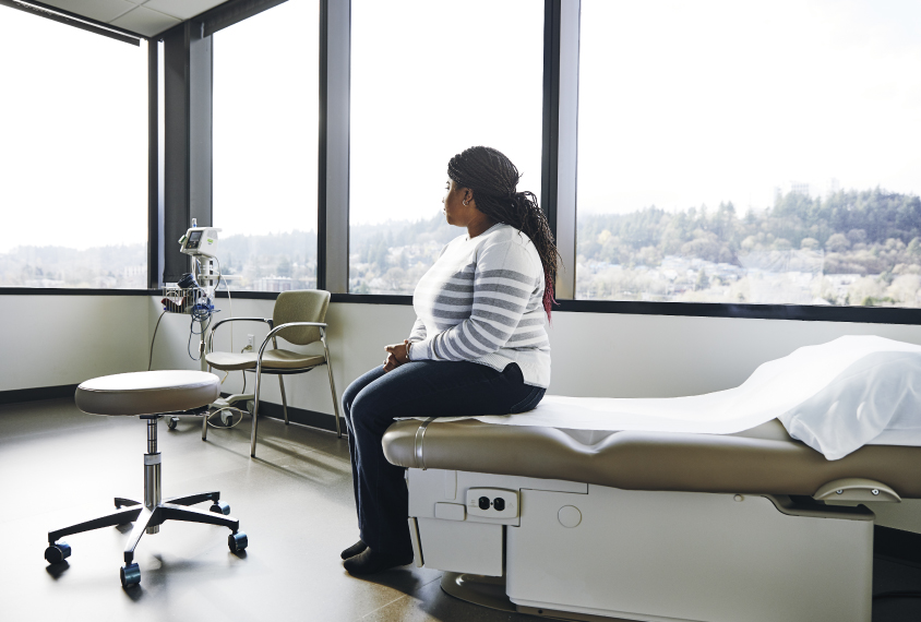 African american woman alone in medical setting
