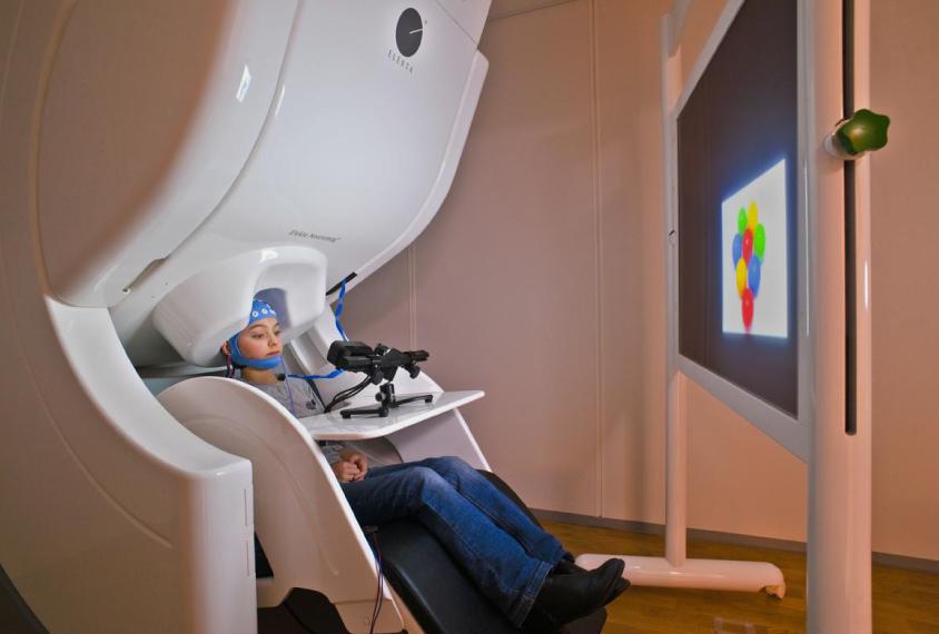Child in magnetoencephalograph (MEG) scanner