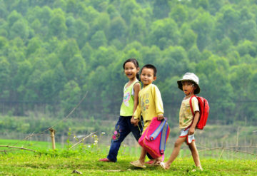 Group of children walking in the countryside in Vietnam.