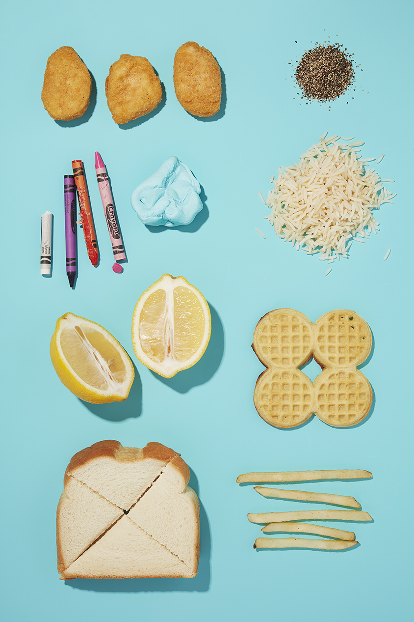 still life of various food and non food items on bright blue background