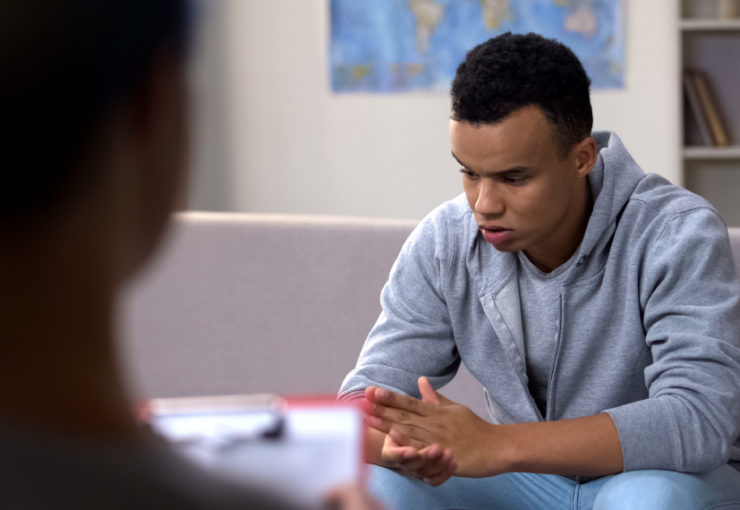 Young black man in inpatient psychiatric care facility