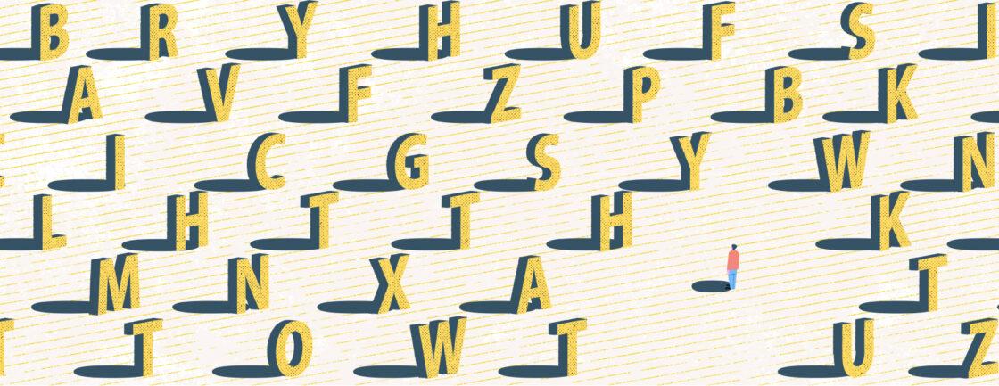 孤独的身影在一堆字母面前显得矮小