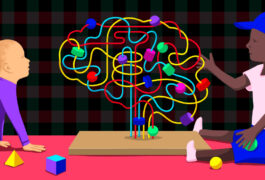 两个孩子正在和一个大脑形状的玩具互动。
