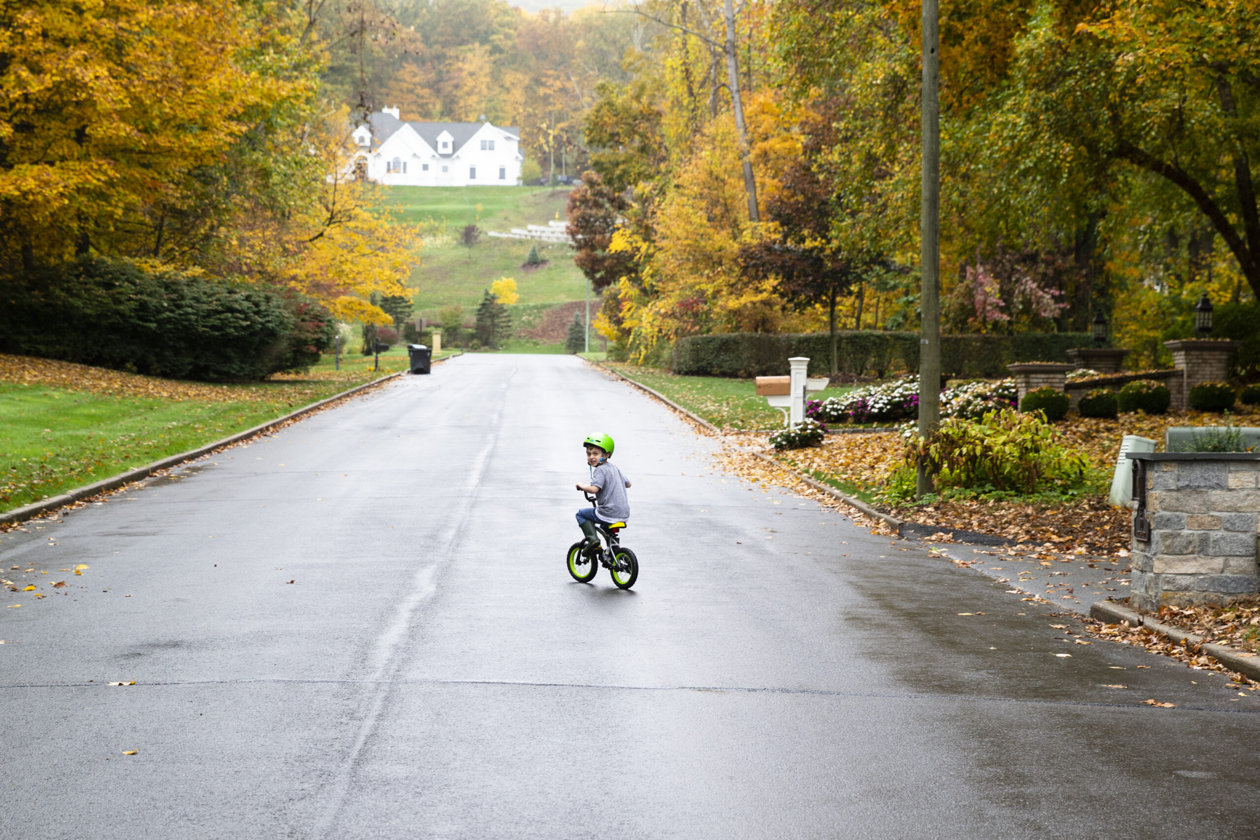 Owen Couture riding a bike in the street near his home.