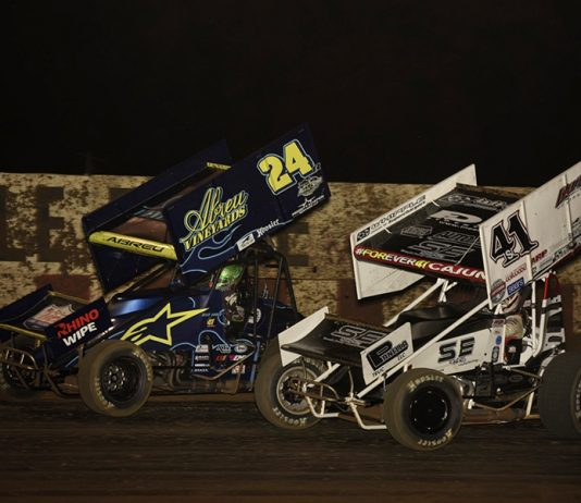 Rico Abreu (24) battles Dominic Scelzi during Thursday's Arctic Cat All Star Circuit of Champions event at Angell Park Speedway. (Mark Funderburk Photo)