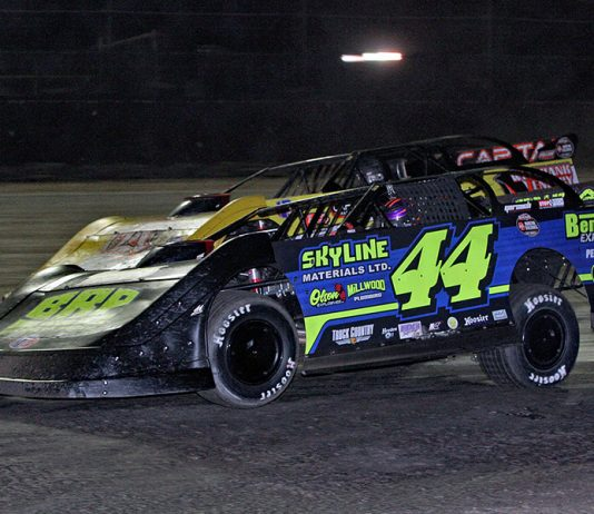 Chris Madden (44) races alongside Shane Clanton earlier this year at Volusia Speedway Park. (Jim Denhamer Photo)