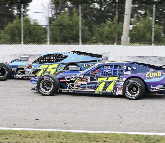 Chris Pasteryak (75) battles Gary Putnam during NASCAR Whelen Modified Tour action at Myrtle Beach Speedway. (Dick Ayers Photo)