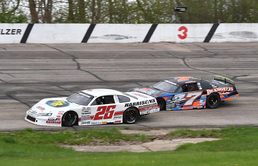 Bubba Pollard (26) takes the lead from John DeAngelis Jr. during Sunday's Joe Shear Classic at Madison Int'l Speedway. (Doug Hornickel Photo)