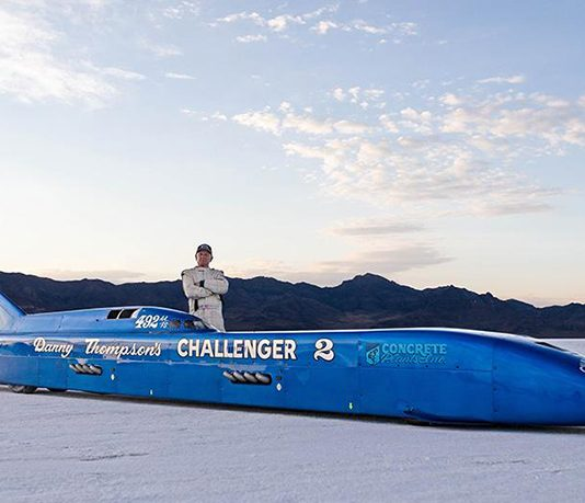 Danny Thompson posing beside his Challenger II land speed car.