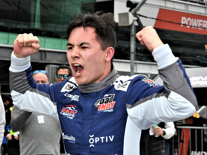 Robert Megennis celebrates his first Indy Lights victory Friday afternoon at Indianapolis Motor Speedway. (Al Steinberg Photo)