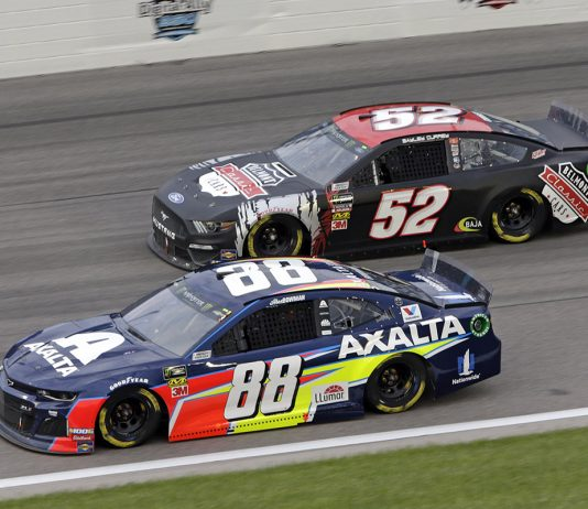 Alex Bowman (88) passes Bayley Currey Saturday at Kansas Speedway. (HHP/Alan Marler Photo)
