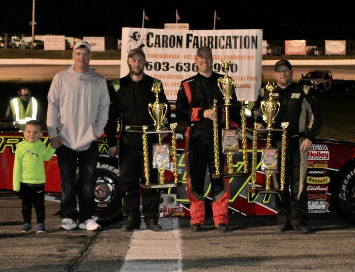 Scott Payea (center) celebrates his victory in the Caron Fabrication Spring Green while flanked by runner-up Quinny Welch (right) and third-place finisher Rich Dubeau (near left). (Mark Alan Sumner photo)